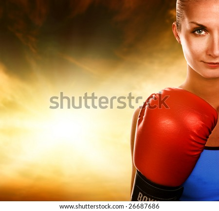 Beautiful woman with red boxing gloves - stock photo