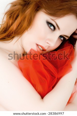Beautiful woman with red hair and blue eyes - stock photo