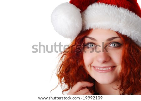 beautiful woman with red hair in a christmas hat
