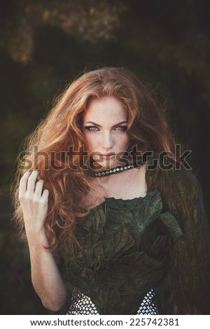 Beautiful woman with red hair in fashion military clothing - stock photo