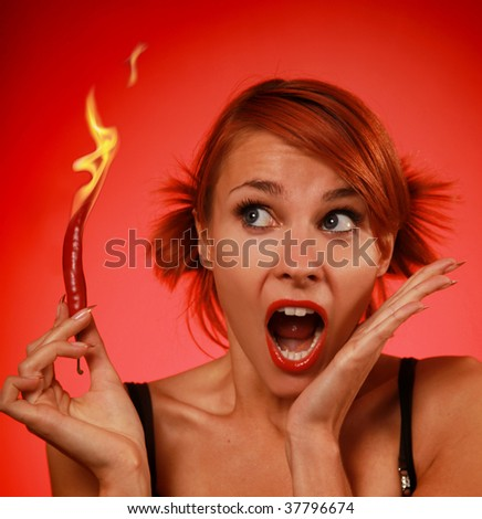 beautiful woman with red hot pepper - stock photo