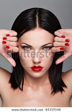 Beautiful Woman With Red Nails and Lips. Makeup and Manicure.  - stock photo