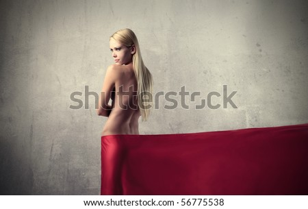 Beautiful woman with red tissue around her waist - stock photo