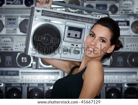 Beautiful woman with retro Boom Box - stock photo