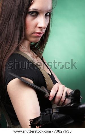 Beautiful woman with rifle - stock photo
