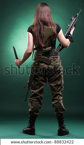 Beautiful woman with rifle plastic Military Army girl Holding Gun green background