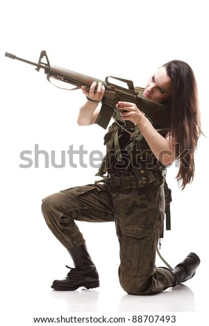 Beautiful woman with rifle plastic Military Army girl Holding Gun white isolated background - stock photo