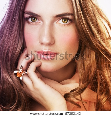 Beautiful woman with ring and salmon color scarf - stock photo