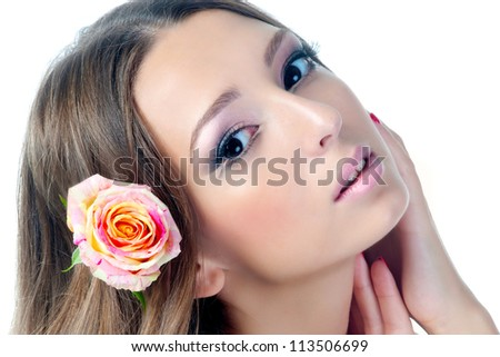 Beautiful woman with rose flower in her hair