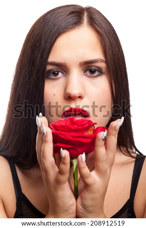 Beautiful woman with rose in hand isolated on white backgroud. Studio shooting. Sensuality. Rose