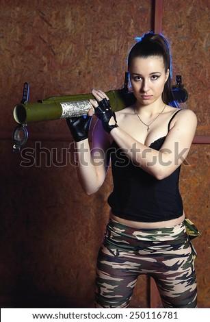 "Beautiful woman with russian bazooka RPG - 18 ""Muha"" - stock photo"