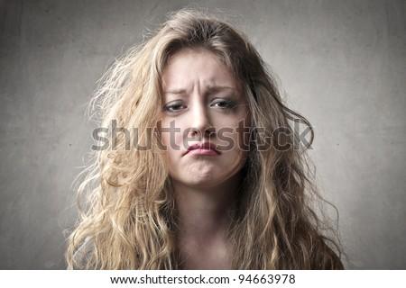 Beautiful woman with sad expression - stock photo