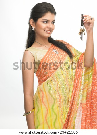 beautiful woman with sari  showing the  bunch of keys - stock photo