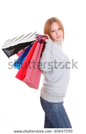 Beautiful woman with shopping bags and gift boxes