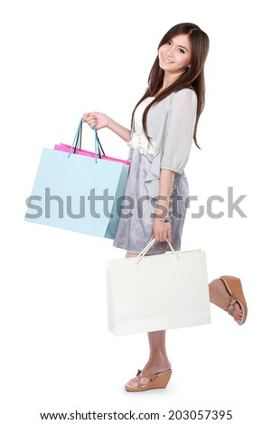 Beautiful woman with shopping bags over white background