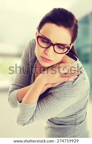 Beautiful woman with shoulder pain - stock photo