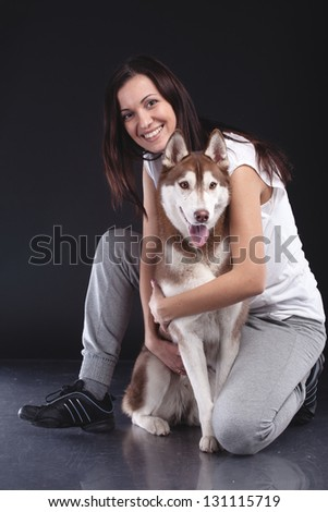 beautiful woman with siberian husky dog