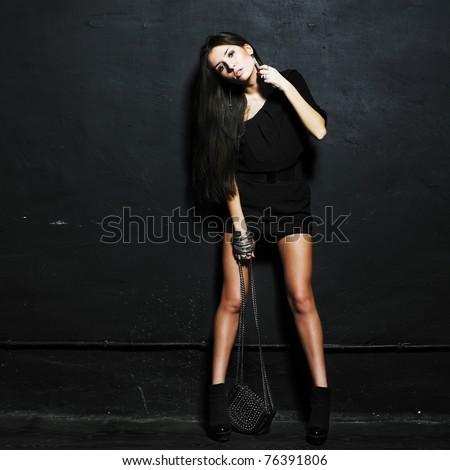 Beautiful woman with small dress and  handbag. Fashion photo - stock photo