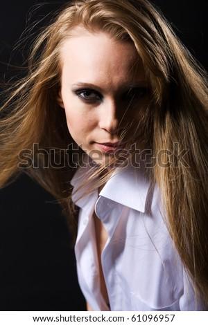 beautiful woman with smokey eyes makeup studio portrait - stock photo