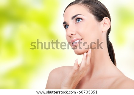 beautiful woman with soft skin on green background