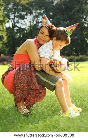 beautiful woman with son in park