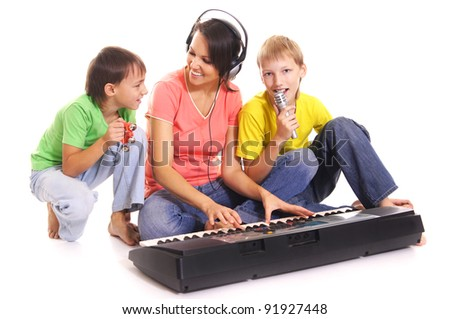 beautiful woman with sons played on a synthesizer - stock photo