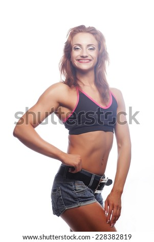 Beautiful woman with sporty slim body - studio shot - stock photo