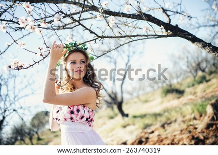 Beautiful  woman with spring flowers - stock photo