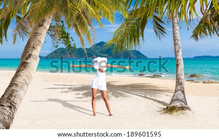 Beautiful woman with straw hat on the tropical beach. Thailand. - stock photo