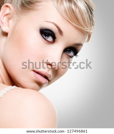 Beautiful  woman with style eye makeup. Closeup face of fashion model - stock photo
