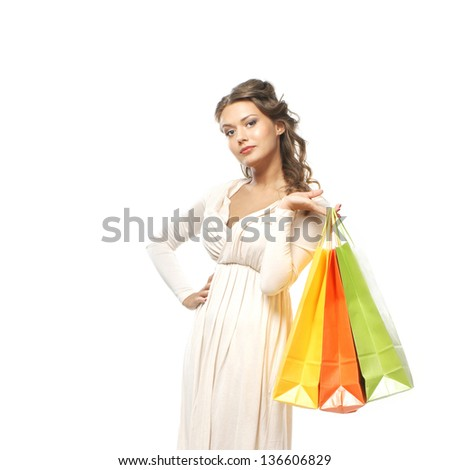 Beautiful woman with the bright shopping bags isolated on white - stock photo
