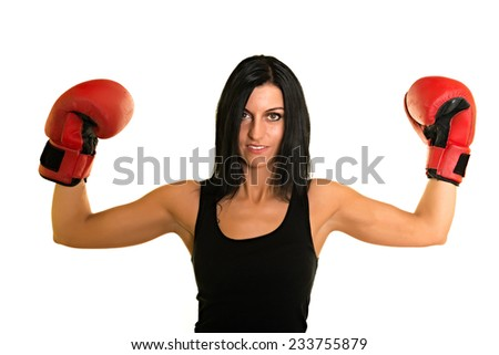 beautiful woman with the red boxing gloves, studio shot - stock photo