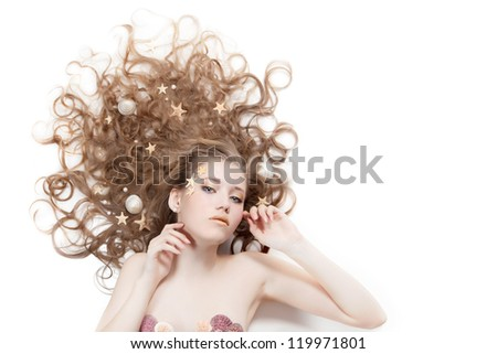 Beautiful woman with the sea shells, starfish and pearls in her hair. On white background with place for text. - stock photo