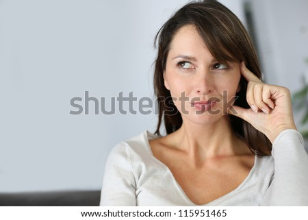 Beautiful woman with thoughtful look - stock photo
