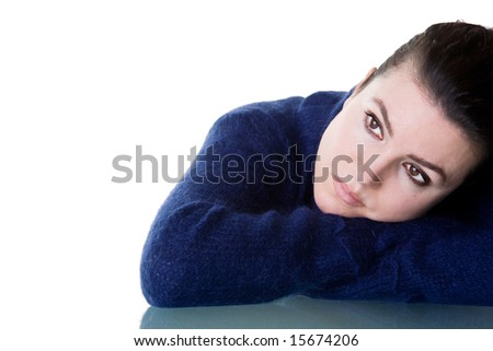 Beautiful woman with thoughtful look. Isolated on white background. - stock photo