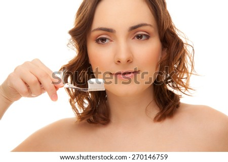 Beautiful woman with toothbrush isolated on white - stock photo