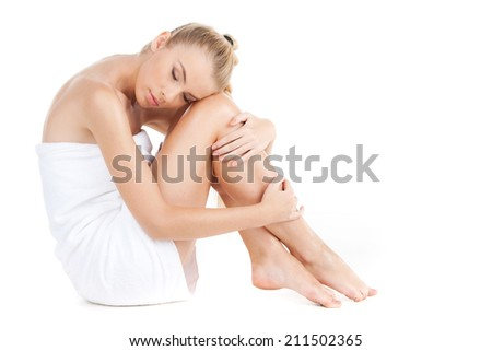 beautiful woman with towel isolated on white. Healthy adult Woman with beauty legs - stock photo