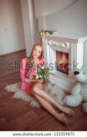 beautiful woman with tulips indoor