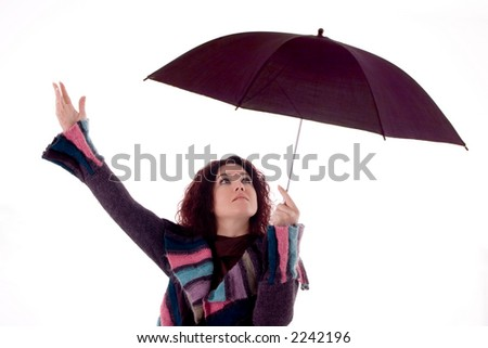 Beautiful woman with umbrella over white background. - stock photo