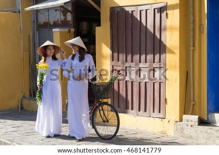 Beautiful woman with Vietnam culture traditional dress, Ao dai is famous traditional costume , vintage style, Hoi an Vietnam