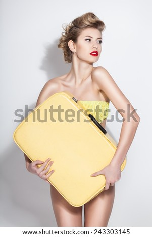 beautiful woman with vintage suitcase - stock photo
