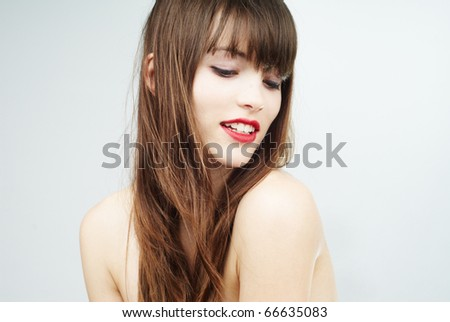 beautiful woman with wind in her hair - stock photo