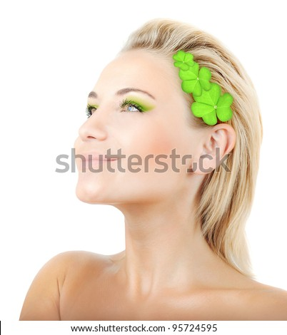 Beautiful woman with wreath of clover, fresh green plant leaves in blond hair, female face portrait isolated over white background, pretty girl with bright makeup, st. Patrick's day, spring holiday - stock photo