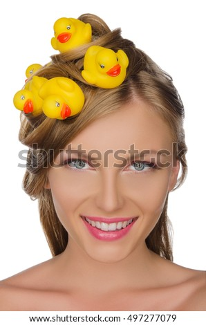 beautiful woman with yellow ducks in her hair isolated on white