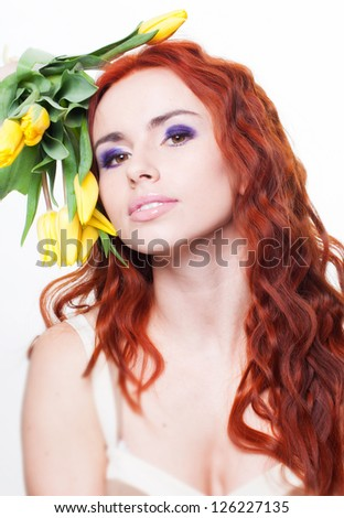 Beautiful woman with yellow tulip flowers