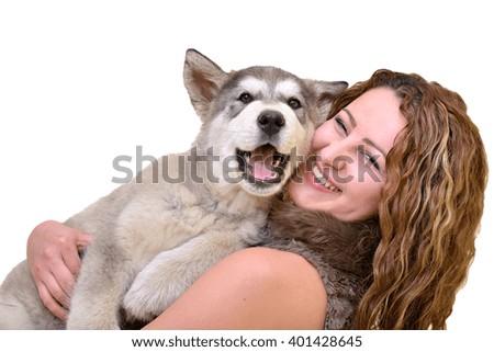 Beautiful woman with young dog Malamute - stock photo