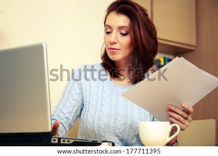 Beautiful woman working at home - stock photo