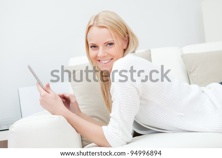 Beautiful woman working on computer - stock photo