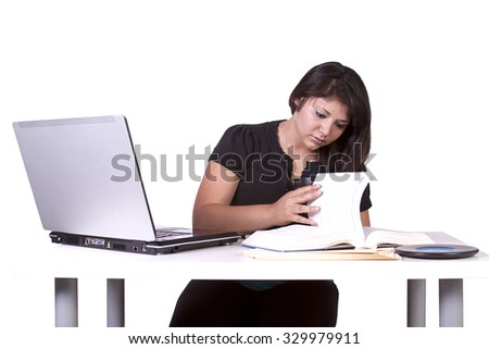Beautiful Woman Working with Books and Laptop on her Desk - stock photo