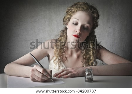Beautiful woman writing a letter - stock photo